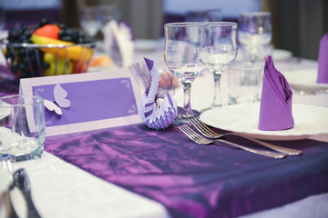 Table with plates and glasses during the wedding