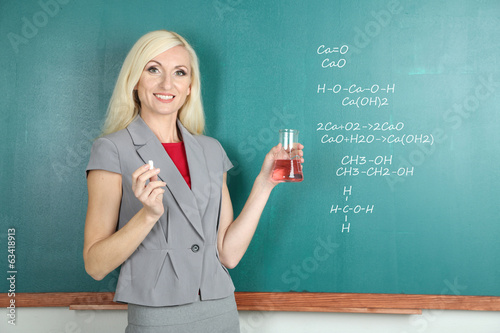 Chemistry teacher explaining formula written