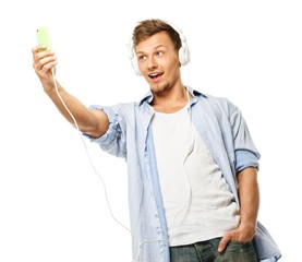 Stylish happy man in headphones taking selfie isolated on white