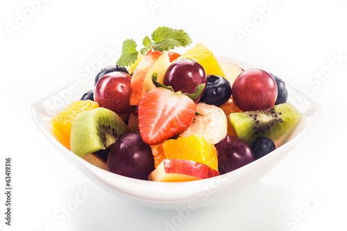Bowl of colorful tropical fruit salad
