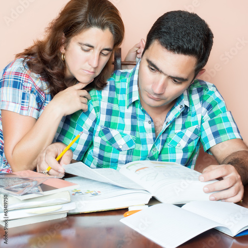 Hispanic couple studying at home