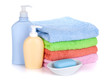 Cosmetics bottles, soap and colored towels