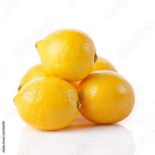 ripe lemons on a white background
