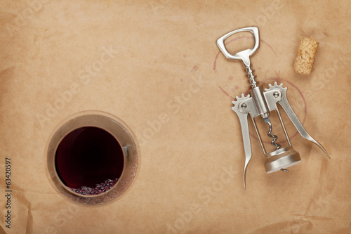 Wine glass, cork and corkscrew with red wine stains