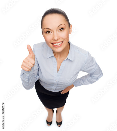 smiling asian businesswoman showing thumbs up