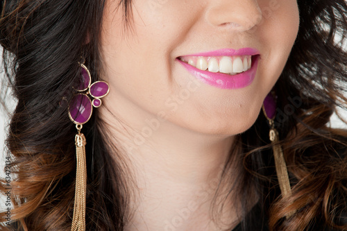 Female lips in pink lipstick