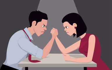 Man and woman armwrestling