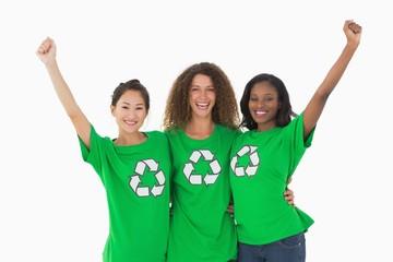 Team of environmental activists cheering at camera
