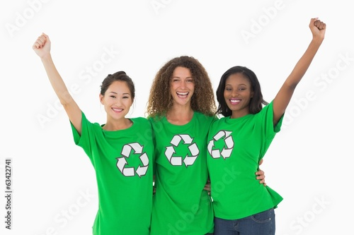 Team of environmental activists cheering at camera