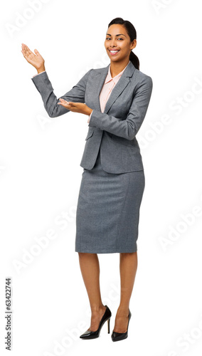 Portrait Of Businesswoman Presenting An Invisible Product
