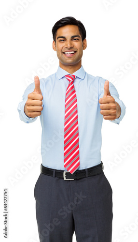 Confident Young Businessman Gesturing Thumbs Up