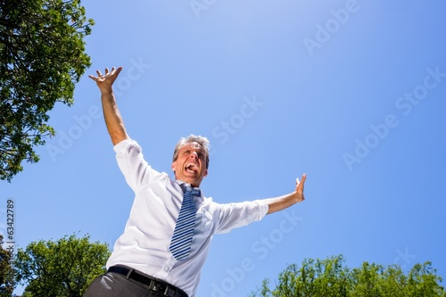 Successful businessman screaming