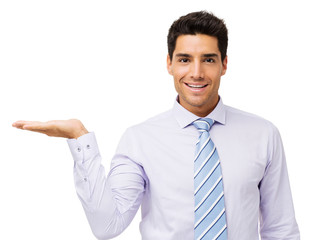 Confident Businessman Displaying Invisible Product