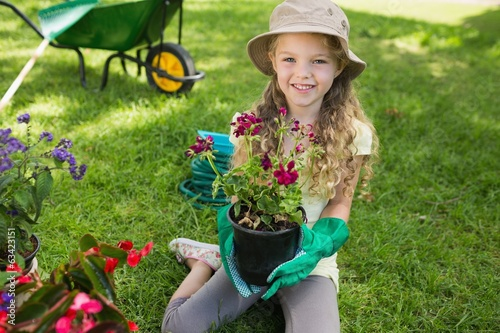 canvas print picture Smiling young girl engaged in gardening
