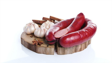 Meat delicacies on kitchen board isolated white background