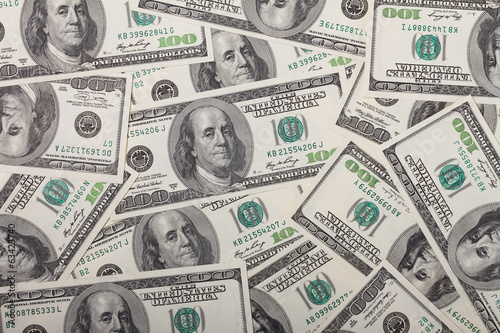 One hundred dollar bills pile background texture
