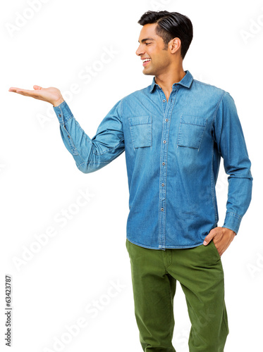 Man With Hand In Pocket Holding Invisible Product