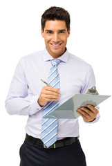 Happy Businessman Holding Clipboard And Pen