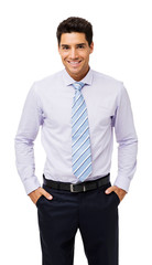 Portrait Of Smiling Businessman With Hands In Pockets