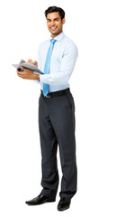 Confident Businessman Holding Clipboard