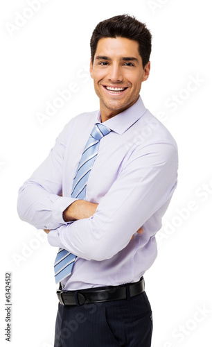 Portrait Of Happy Businessman With Arms Crossed