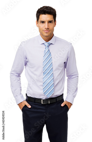 Portrait Of Confident Businessman With Hands In Pockets
