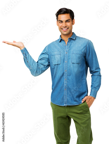 Confident Man With Hand In Pocket Holding Invisible Product