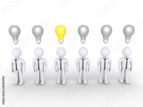 Businessman stands out of others with lightbulb
