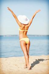 girl in bikini posing on the beach