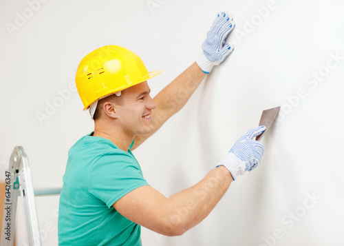 smiling man in helmet doing renovations at home