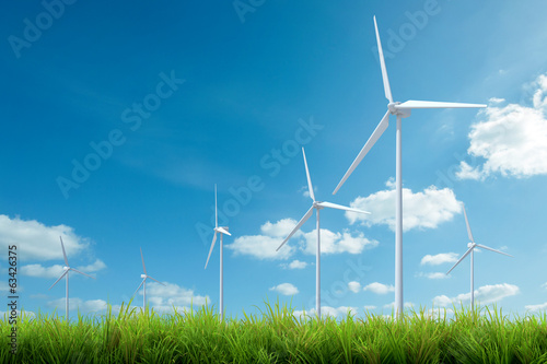 canvas print picture wind turbine with grass and blue sky