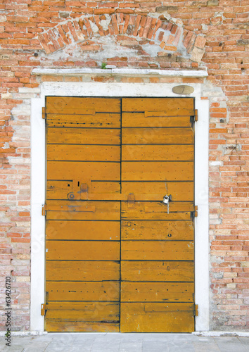 Orange door in the island of Giudecca in Venice