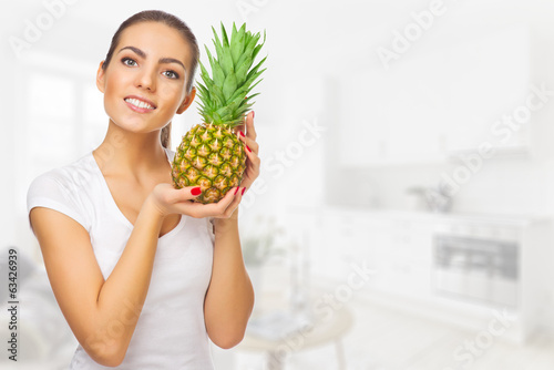 Girl with pineapple at light room