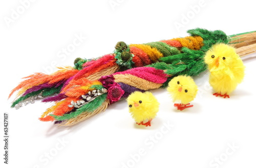 Easter chickens with colorful palm on white background