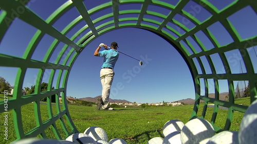 Slow Motion - Man Golfing At Driving Range