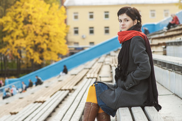 Girl with red scarf at stadium