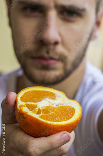 Man holding an orange