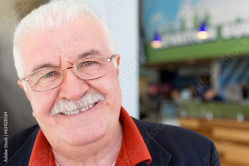 Friendly sincere senior man in glasses
