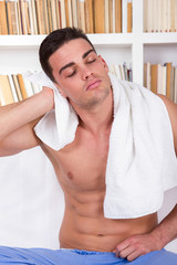 relaxed man drying hair with white towel