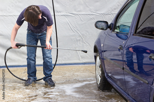 Man washing his car at self-service station