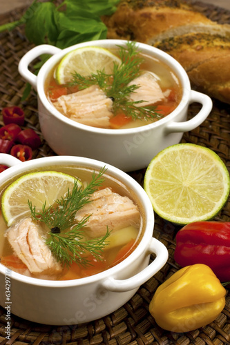 Bowls with salmon soup and veggies