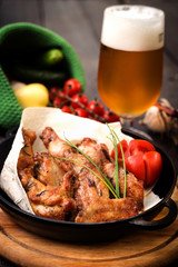 chicken wings with celery, carrot and glass of beer