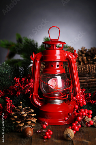 Red kerosene lamp on dark background