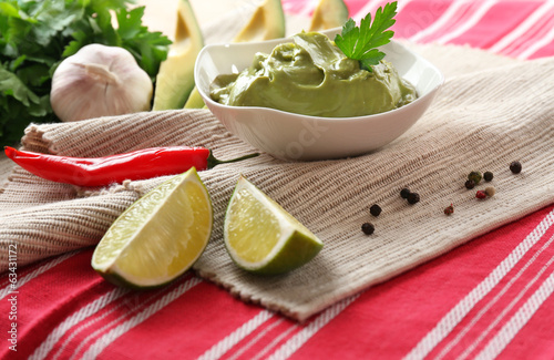Fresh guacamole in bowl on table