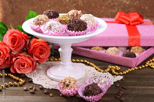 Set of chocolate candies on table on brown background