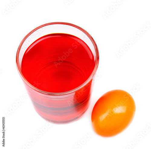 Glass with paint for Easter eggs and egg, isolated on white