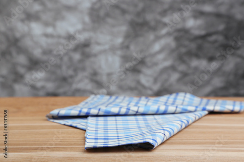 Background with wooden table and tablecloth