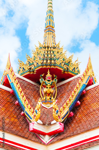 Garuda statue on top of traditional Thai style church