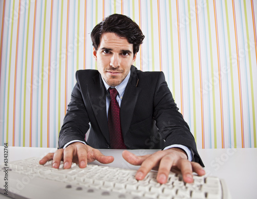 Businessman using his computer