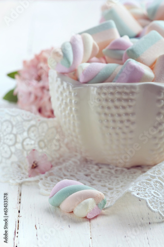 Pastel colored marshmallows in a bowl, closeup shot, toned photo